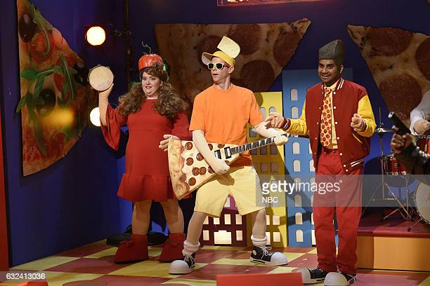 LIVE 'Aziz Ansari' Episode 1716 Pictured Aidy Bryant as Mary Nara Mikey Day as Cheesy Steve Aziz Ansari as Peppy Ronnie during the 'Pizza Town'...