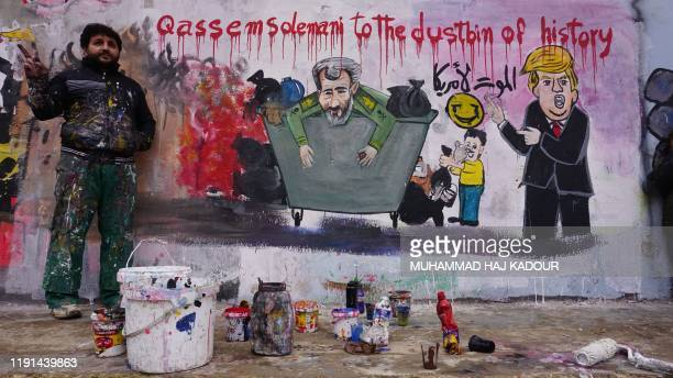 Aziz Asmar one of two Syrian painters who completed a mural on January 3 2020 following the killing of Iranian Revolutionary Guards commander Qasem...