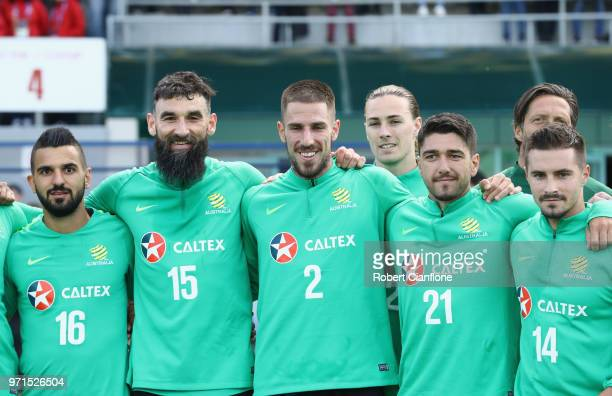 Aziz Behich Mile Jedinak Milos Degenek Dimitri Petratos and Jamie Maclaren of Australia pose after an Australian Socceroos training session at...