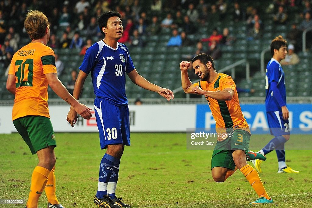 Aziz Behich (2nd R) of Australia celebrates a goal during the EAFF East Asian Cup 2013 Qualifying match between Chinese Tapei and the Australian Socceroos at Hong Kong Stadium on December 9, 2012 in So Kon Po, Hong Kong.