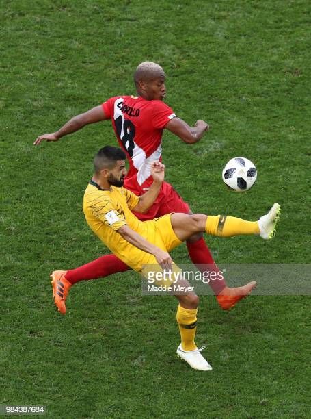 Aziz Behich of Australia controls the ball under pressure from Andre Carrillo of Peru during the 2018 FIFA World Cup Russia group C match between...