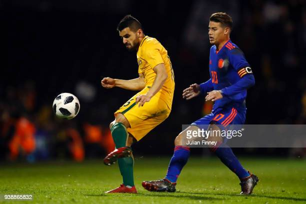 Aziz Behich of Australia is challenged by James Rodriguez of Columbia during the International friendly between Australia and Colombia at Craven...