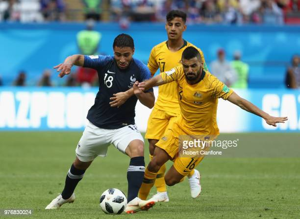 Aziz Behich of Australia is challenged by Nabil Fekir of France during the 2018 FIFA World Cup Russia group C match between France and Australia at...