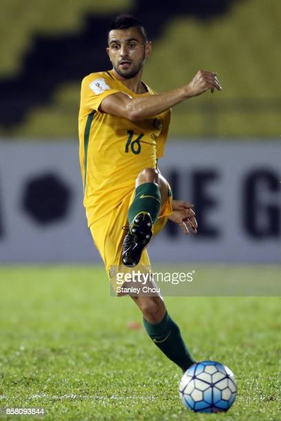 Aziz Behich of Australia kicks during the 2018 FIFA World Cup Asian Playoff match between Syria and the Australia Socceroos at Hang Jebat Stadium on...