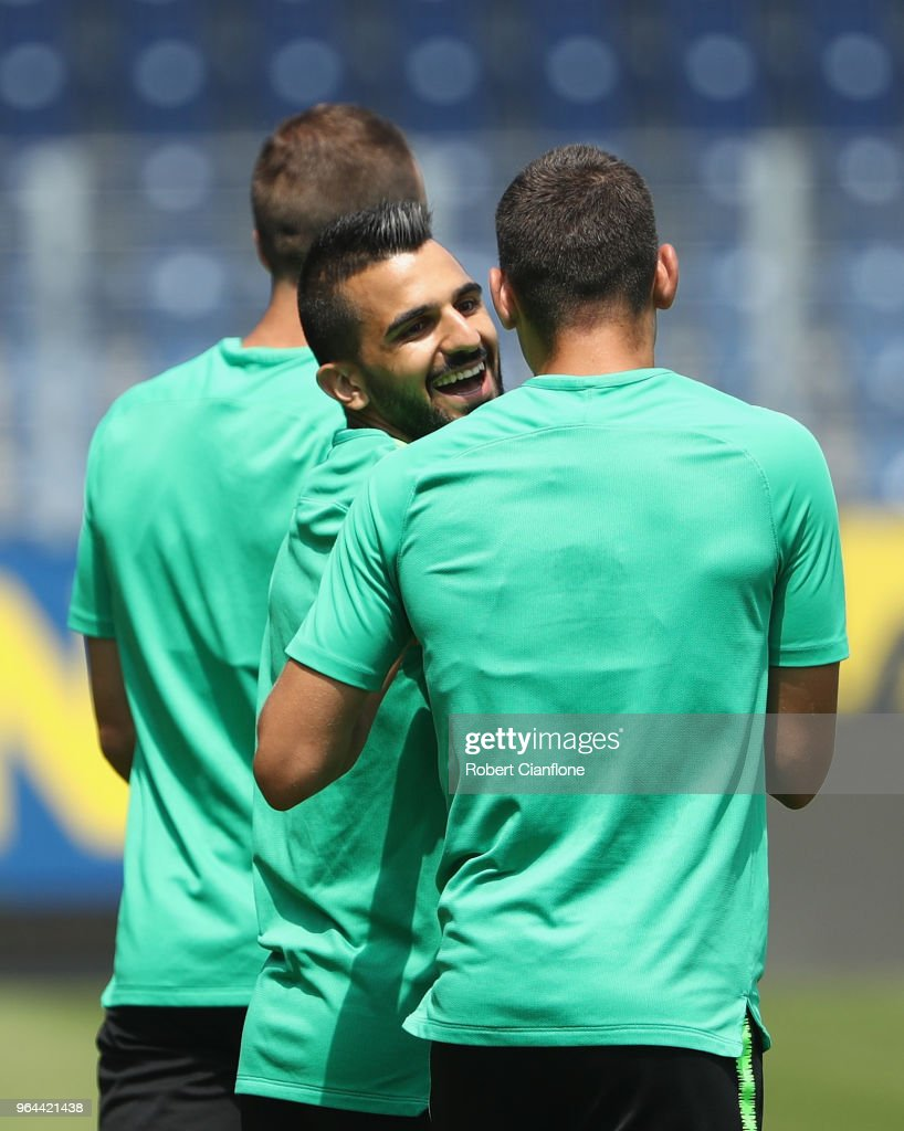 Aziz Behich of Australia laughs with Fran Karacic of Australia during an Australia Socceroos training session at NV Arena on May 31, 2018 in Sankt Polten, Austria.