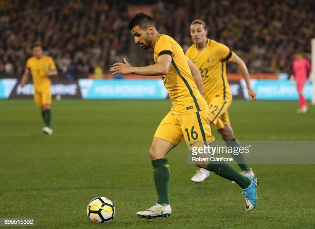 Aziz Behich of Australia runs with the ball during the Brasil Global Tour match between Australian Socceroos and Brazil at Melbourne Cricket Ground...