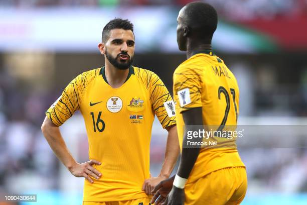 Aziz Behich of Australia talks to his team mate Awer Mabil during the AFC Asian Cup Group B match between Australia and Jordan at Hazza Bin Zayed...