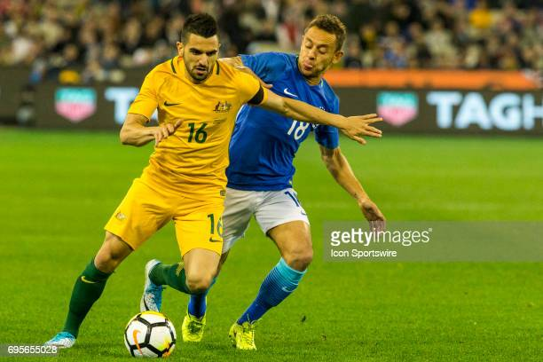 Aziz Behich of the Australian National Soccer Team and Marcio Rafael Souza of the Brazilian National Football Team contest the ball during the...