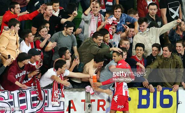 Aziz Behich of the Heart gets hugged by the fans after the round six ALeague match between the Melbourne Heart and the Brisbane Roar at AAMI Park on...
