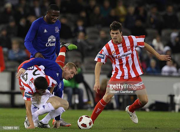 Aziz Behich of the Melbourne Heart challenges Tony Hibbert of Everton during a pre-season friendly match between Melbourne Heart and Everton at...