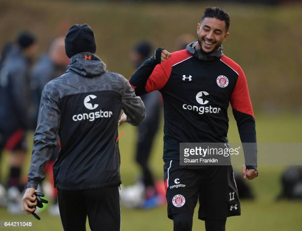 Aziz Bouhaddouz greets a teamate during a training session of FC St.Pauli on February 23, 2017 in Hamburg, Germany.