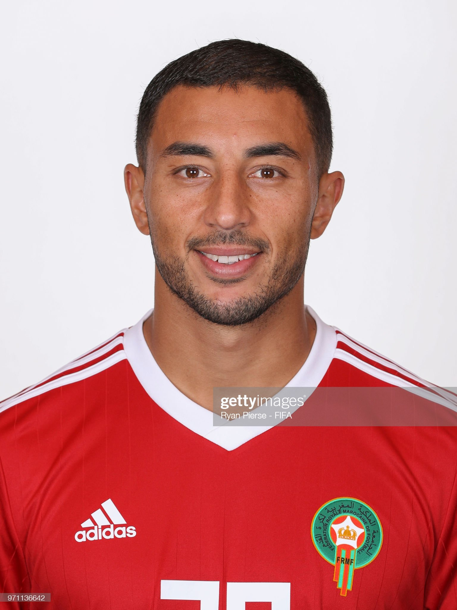 Norteafricanos Aziz-bouhaddouz-of-morocco-poses-during-the-official-fifa-world-cup-picture-id971136642?s=2048x2048