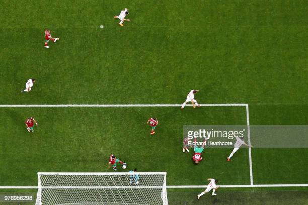 Aziz Bouhaddouz of Morocco scores an own goal for Iran's first goal as Majid Hosseini Mehdi Taremi and Karim Ansarifard of Iran celebrate during the...