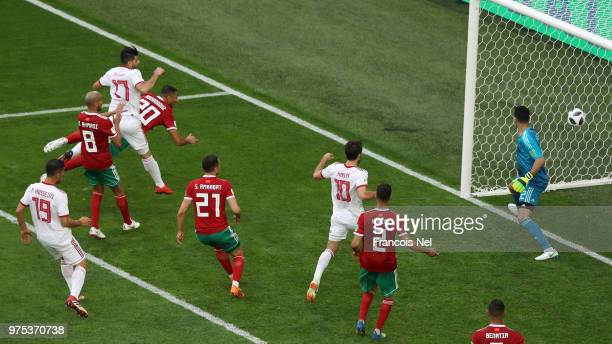 Aziz Bouhaddouz of Morocco scores an own goal for Iran's first goal during the 2018 FIFA World Cup Russia group B match between Morocco and Iran at...