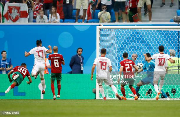 Aziz Bouhaddouz of Morocco scores an own goal Iran's first during the 2018 FIFA World Cup Russia group B match between Morocco and Iran at Saint...