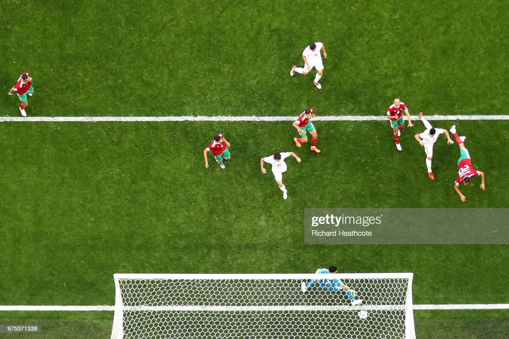 Aziz Bouhaddouz of Morocco scores an own goal past Monir El Kajoui for Iran's first goal during the 2018 FIFA World Cup Russia group B match between Morocco and Iran at Saint Petersburg Stadium on June 15, 2018 in Saint Petersburg, Russia.
