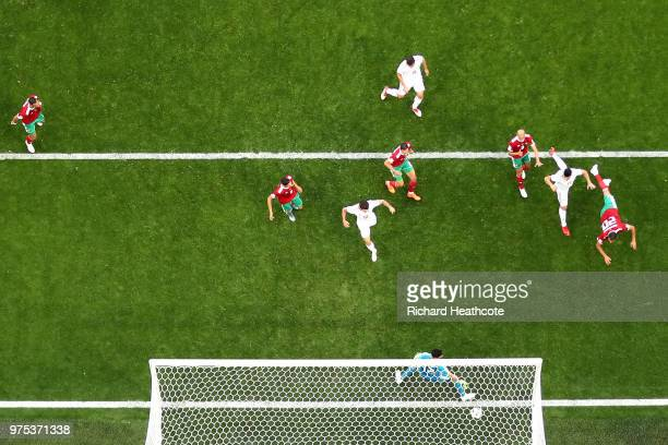 Aziz Bouhaddouz of Morocco scores an own goal past Monir El Kajoui for Iran's first goal during the 2018 FIFA World Cup Russia group B match between...