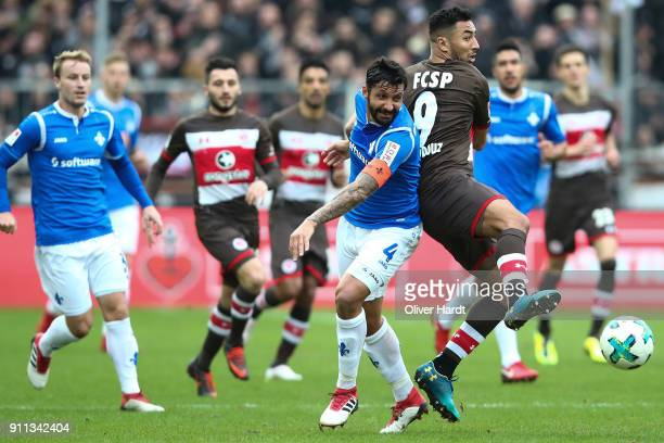 Aziz Bouhaddouz of Pauli and Aytac Sulu of Darmstadt compete for the ball during the Second Bundesliga match between FC St Pauli and SV Darmstadt 98...