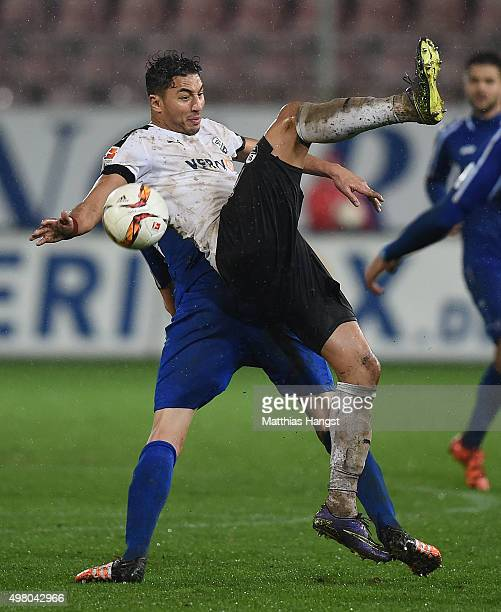 Aziz Bouhaddouz of Sandhausen and Dominic Peitz of Karlsruhe compete for the ball during the Second Bundesliga match between SV Sandhausen and...