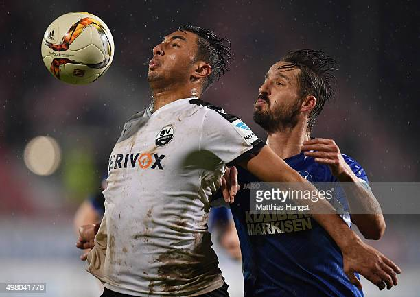 Aziz Bouhaddouz of Sandhausen and Martin Stoll of Karlsruhe compete for the ball during the Second Bundesliga match between SV Sandhausen and...