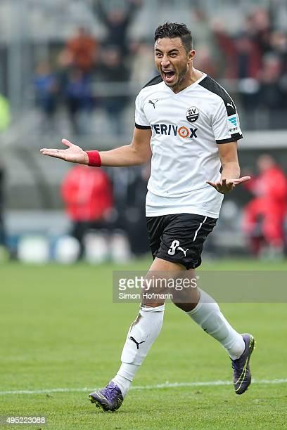 Aziz Bouhaddouz of Sandhausen celebrates his team's first goal during the Second Bundesliga match between SV Sandhausen and RB Leipzig at...