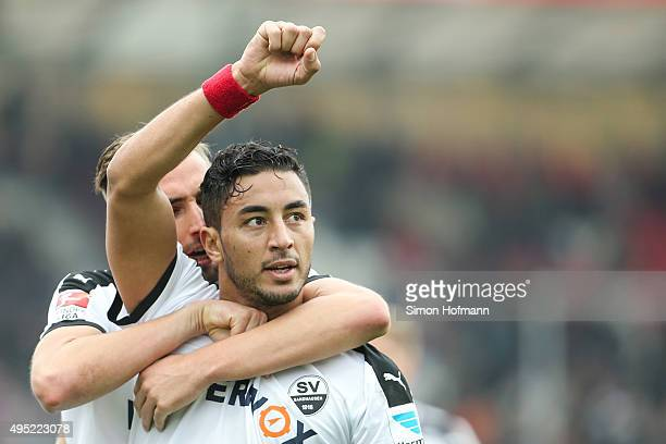 Aziz Bouhaddouz of Sandhausen celebrates his team's first goal with team mates during the Second Bundesliga match between SV Sandhausen and RB...