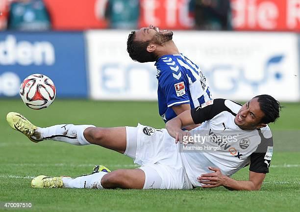Aziz Bouhaddouz of Sandhausen tackles Daniel Gordon of Karlsruhe during the Second Bundesliga match between SV Sandhausen and Karlsruher SC at...