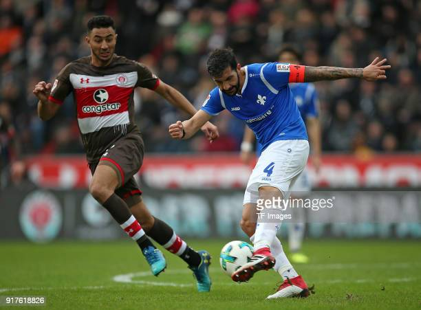 Aziz Bouhaddouz of St Pauli and Aytac Sulu of Darmstadt battle for the ball during the Second Bundesliga match between FC St Pauli and SV Darmstadt...