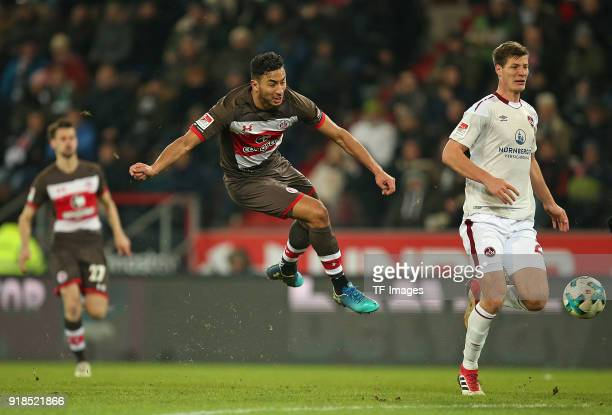 Aziz Bouhaddouz of St Pauli and Patrick Erras of Nuernberg battle for the ball during the Second Bundesliga match between FC St Pauli and 1 FC...