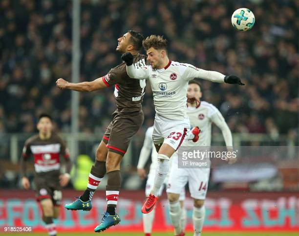 Aziz Bouhaddouz of St Pauli and Tim Leibold of Nuernberg battle for the ball during the Second Bundesliga match between FC St Pauli and 1 FC...