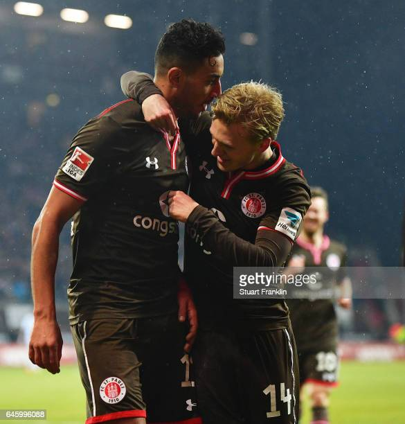 Aziz Bouhaddouz of St Pauli celebrates scoring the fourth goal with Mats M¿ller Daehli during the Second Bundesliga match between FC St Pauli and...