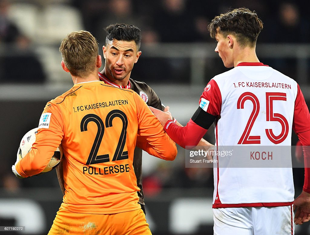 Aziz Bouhaddouz of St Pauli has words with Julian Pollersbeck of 1.FC Kaiserslautern during the Second Bundesliga match between FC St. Pauli and 1. FC Kaiserslautern at Millerntor Stadium on December 2, 2016 in Hamburg, Germany.