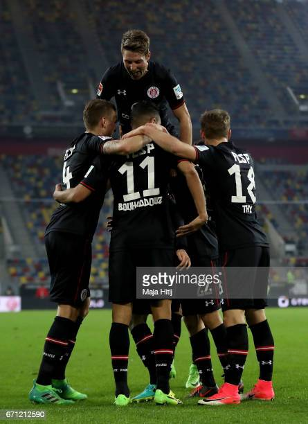 Aziz Bouhaddouz of St.Pauli celebrate with his team mates after he scores the 3rd goal during the Second Bundesliga match between Fortuna Duesseldorf...