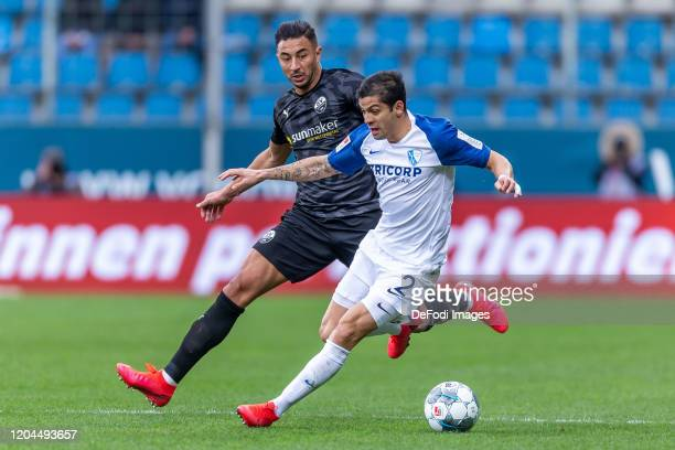 Aziz Bouhaddouz of SV Sandhausen and Cristian Gamboa of VfL Bochum battle for the ball during the Second Bundesliga match between VfL Bochum 1848 and...