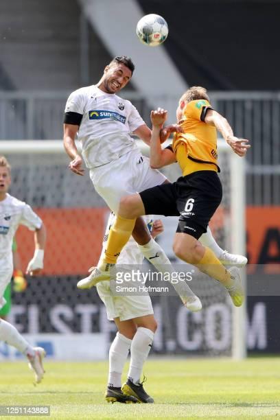 Aziz Bouhaddouz of SV Sandhausen and Marco Hartmann of SG Dynamo Dresden jump for a header during the Second Bundesliga match between SV Sandhausen...