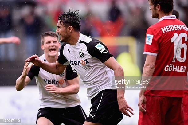 Aziz Bouhaddouz of SV Sandhausen celebrates as he scores their first goal during the Second Bundesliga match between SV Sandhausen and 1. FC...