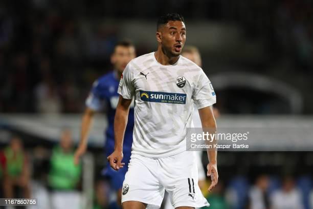 Aziz Bouhaddouz of SV Sandhausen reacts during the Second Bundesliga match between Karlsruher SC and SV Sandhausen at Wildparkstadion on September...
