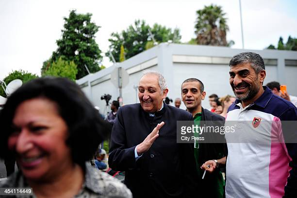 Aziz Pahad joined thousands of people with flowers banners and posters on December 6 2013 in Johannesburg outside former president Nelson Mandela's...