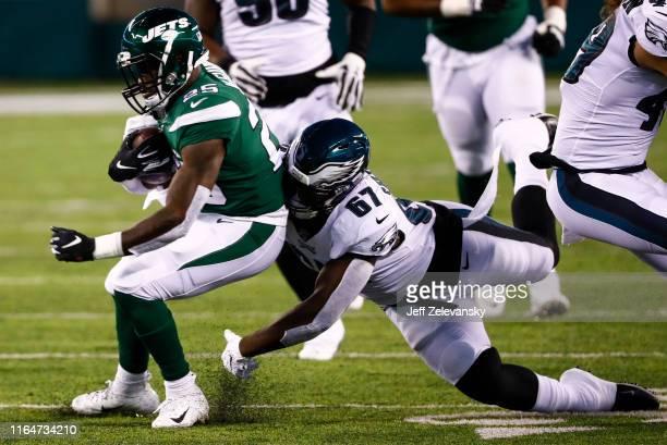 Aziz Shittu of Philadelphia Eagles takes down Elijah McGuire of the New York Jets during the preseason game at MetLife Stadium on August 29 2019 in...