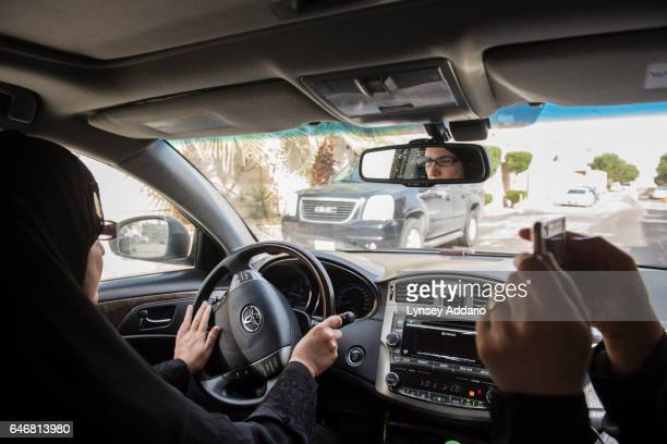 Aziz Yousef drives in Riyadh while Eman Nafjan films her for a driving video for the driving campaign in Riyadh Saudi Arabia March 20 2015 Both women...