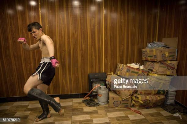 Aziz Zafari from the war torn province of Mydan Wardak gets warmed up in a room before his amateur fight at Snow Leopard Fighting Championship on May...