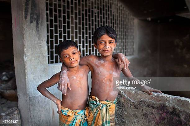 Azizul is 12 years old and his younger brother Rafiqule is 9 They work together as manual labourers in a soap factory in Dhaka