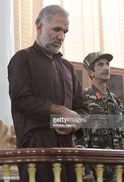 Azizullah one of seven men who gangraped four women on August 23 stands in court in Kabul Afghanistan on September 7 2014 Afghanistan handed the...