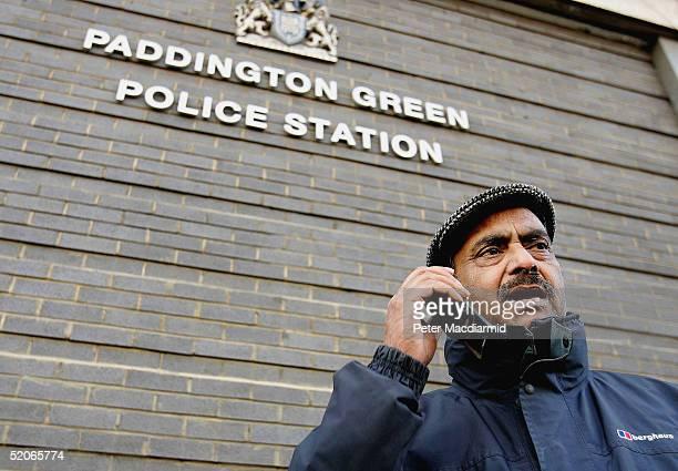 Azmat Begg the father of Moazzam Begg talks on the telephone outside Paddington Green police station January 26 in London England Moazzam Begg Martin...