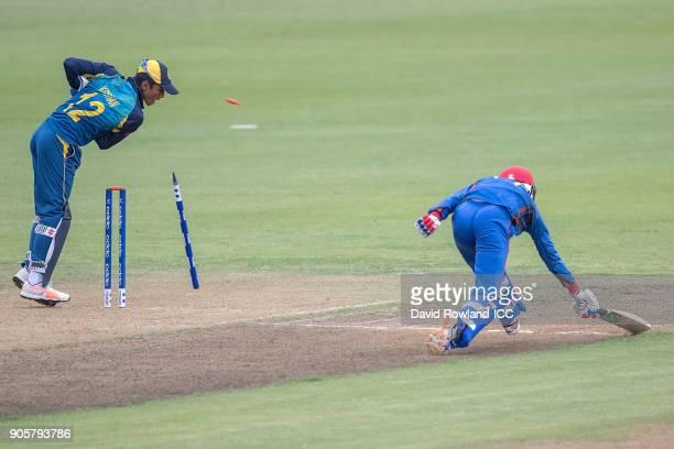 Azmatullah Omarzai of Afghanistan ran out by Nipun Malinga of Sri Lanka during the ICC U19 Cricket World Cup match between Sri Lanka and Afghanistan...