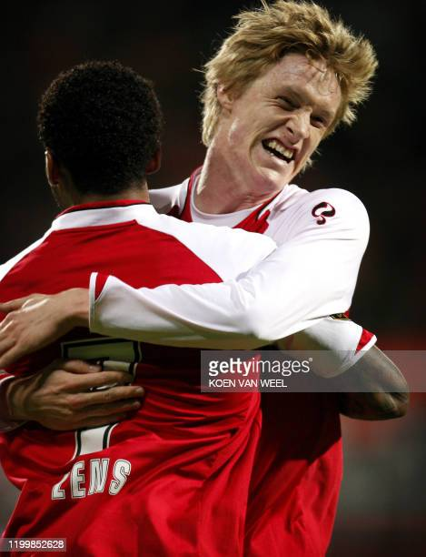 Players Rasmus Elm and Jeremain Lens celebrate the 1-0 against VVV on November 28, 2009. AFP PHOTO ANP KOEN VAN WEEL netherlands out - belgium out