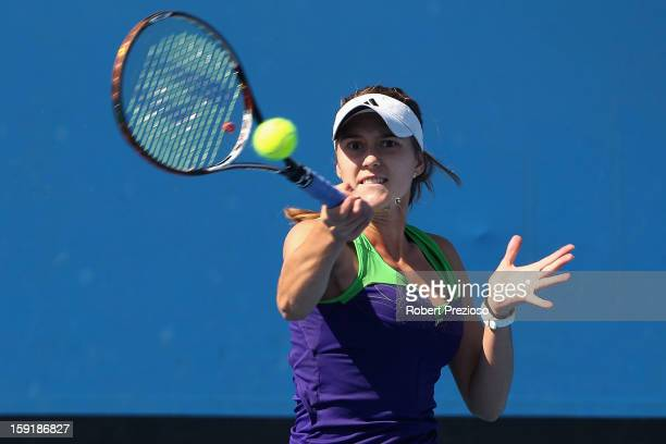 Azra Hadzic of Australia plays a forehand during her matach against Michelle Larcher De Brito of Portugal during Australian Open qualifying at...