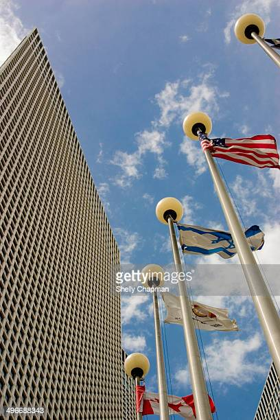 CONTENT] Azrieli skyscrappers towers in TelAviv with the Israeli American and Canadian flags in the foreground
