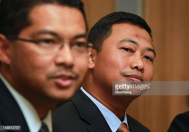 Azrulnizam Abdul Aziz chief executive officer of Al Rajhi Bank right listens during an interview in Kuala Lumpur Malaysia on Wednesday April 18 2012...