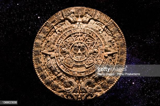 aztec calendar stone carving in space - ancient civilization stock photos and pictures